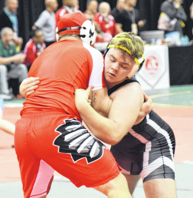 Graham's Johnny Shafer battles with Wapakoneta's Brenan Knueve during Friday's quarterfinals.