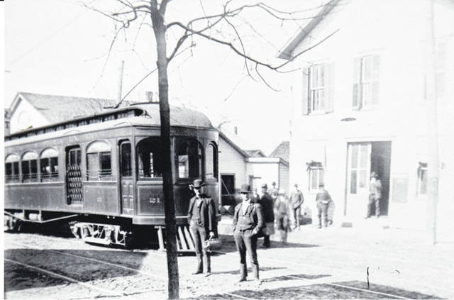 This a circa 1915 photo of a Springfield, Troy and Piqua traction line car with Dr. William Hyde (holding medicine satchel). Hyde graduated from the Columbus Medical College in 1889. He practiced medicine in Christiansburg from 1893 until he retired. His son, Dr. Willard Hyde, joined him in practice in 1904. Source: Christiansburg, Ohio Reflections of Our Village A Bicentennial History 1817-2017. The Champaign County Historical Society thanks author and CCHS Trustee Candy Gilliam for sharing this photo. <em>The Champaign County Historical Society is an all-volunteer, not-for profit organization that preserves, protects, archives and displays the artifacts that tell the Champaign County story. The society depends upon donations and dues to provide a free public museum, open 10 a.m.-4 p.m. Mondays and Tuesdays.</em>