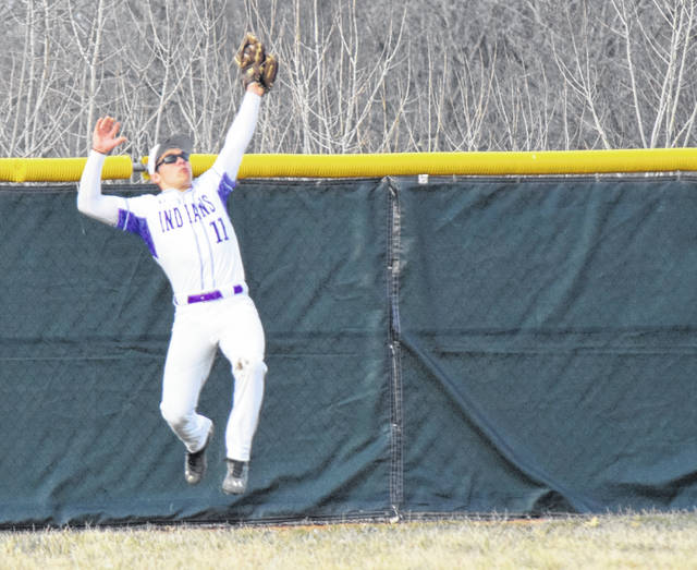 Mechanicsburg's Noah Wolf makes a jumping catch near the warning track against Northeastern on Thursday.