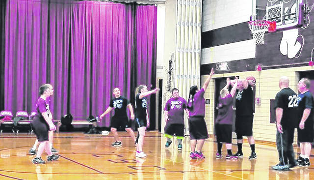 Urbana police officers compete against Special Olympics athletes in last year's game.