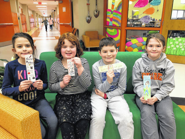 West Liberty-Salem 2nd graders spent a month designing bookmarks with quotes, titles, illustrations, etc. before voting on a winning bookmark from each class. Winning themes were Harry Potter, Naughty Mable, Nibbles the Book Monster and Junie B. Jones. The bookmarks were to be distributed throughout the elementary and the grand prize winner will have his or her bookmarks available for visitors of the Champaign County Library. Class winners shown with their bookmarks are, from left, Makayla Lackey, Isabella Spencer, Carter Pratt and Ava Martin.