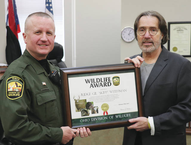 Champaign County Municipal Court Judge Gil S. Weithman received a wildlife award Wednesday. The award was presented by state Wildlife Officer Jeffrey Tipton.