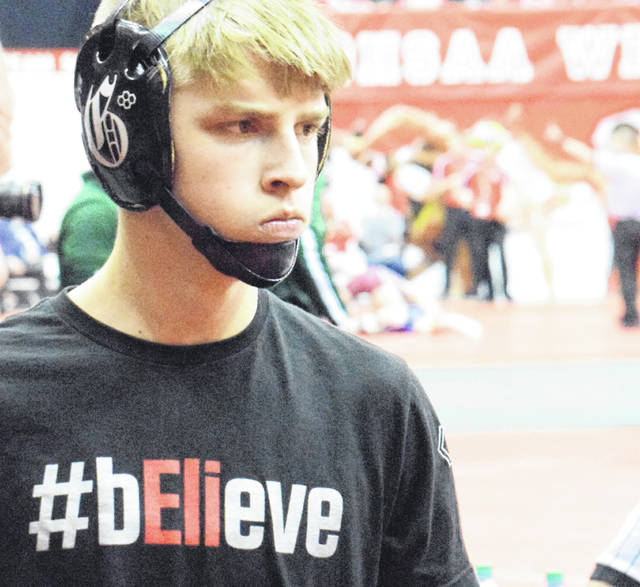 Graham's Trace Braun prepares for a match Friday at the OHSAA state wrestling championships wearing one of the Falcons' team warmup shirts. The Graham community lost GHS graduate and University of Wisconsin wrestler Eli Stickley in an automobile crash last July, but honored his memory this week and all season. The Falcons are aiming for their 19th straight Division II state wrestling tournament title. See Sports page 9 for coverage from Friday's action in Columbus.