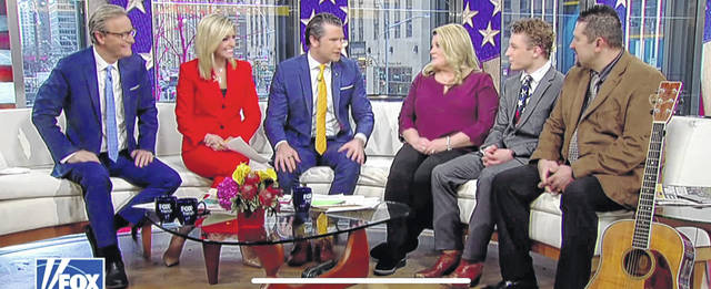 Isaac Bryant (second from right) sits between his parents April and Barry Bryant during a Wednesday morning appearance on a cable TV show called Fox & Friends.