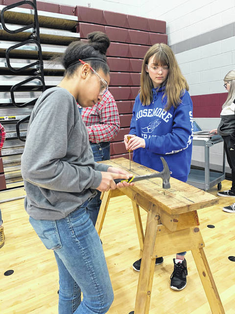 Keyanna Green and Courtney Gunsaulies participate in Ag Olympics during lunch on March 15.