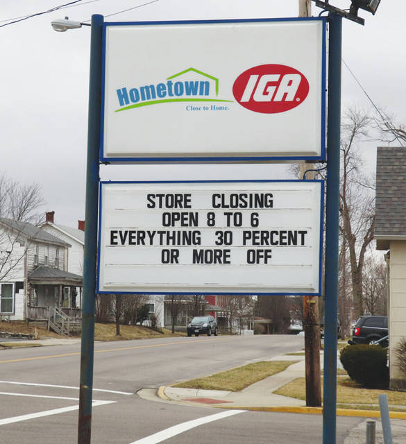 The IGA store in St. Paris is preparing to close, as this sign in front of the business announces.