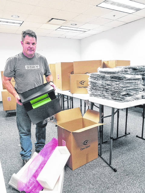 Christopher Logan, Champaign County Board of Elections Tech Support, unloads the shipment of new voting machines from Clear Ballot on Monday.