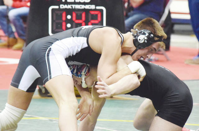 Graham's Alek Martin (pictured) decisioned Micah Norwood of Columbus Bishop Hartley, 6-5, in an ultimate tie-breaker to claim the title at 138 pounds at the Division II state wrestling tournament on Saturday.