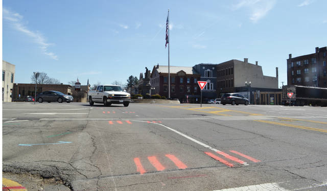 The roundabout in Monument Square is being prepared for an intersection upgrade that could begin as early as April. This photo shows the square from the northwest corner crosswalk looking toward the southeast area businesses.