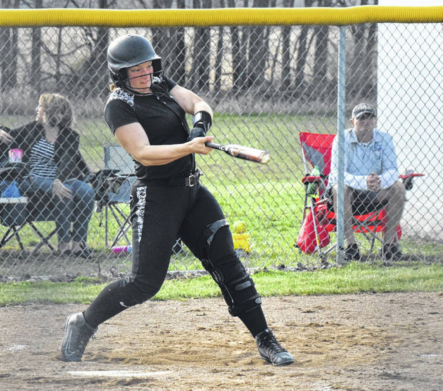 Graham's Alyssa Theodor blasts a home run in the first inning of Monday's game against Urbana. Theodor leads the CBC in dingers with six.