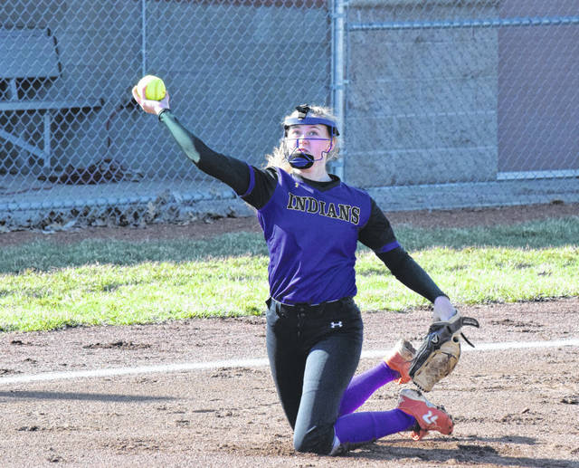 Mechanicsburg's Francys King completes a double play from her knees on Tuesday against Triad. King dove from her pitching circle to catch a popped up bunt and threw the runner out before she tagged up at first.