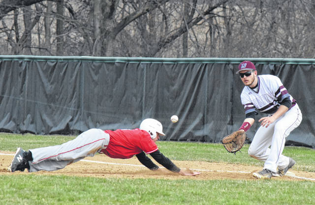 Urbana first baseman Gabe Spiers (right) helps hold the London runner close to the bag early in Friday's contest against the Red Raiders.