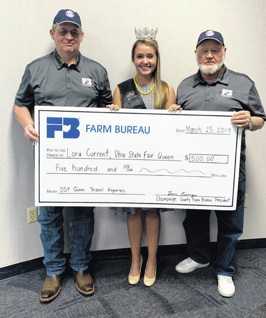 From left are Mark Townsley, Champaign County Farm Bureau board member, Lora Current, state fair queen, and Tom Nisonger, Champaign County Farm Bureau president.