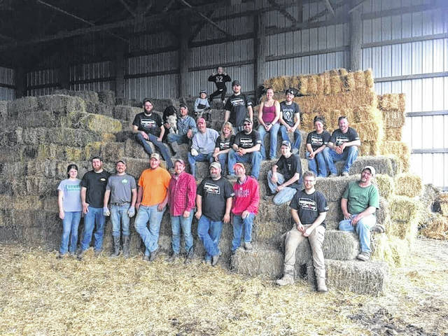 This photo includes Champaign County residents Josh and Chrissy Yoder (sitting together in jeans and T-shirts on the right) and others who traveled with supplies to aid in the Nebraska flood relief efforts. Josh Yoder is on the board of the Champaign County Farm Bureau, which donated $650 to the effort.