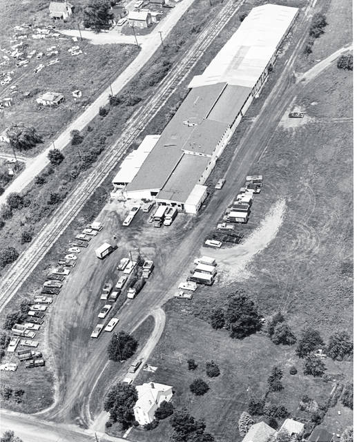 This is an aerial photo of Champaign Livestock Sales taken on June 28, 1971. The livestock sales facility was located at 430 W. Light St. just east of the big four railroad. Champaign Livestock Sales was owned by Gale Locke and managed by Dow Ward at this time. Livestock sales were held weekly on Wednesdays. June 28, 1971, was a Monday, thus the photo was not taken on a sales day. The area is now occupied by houses. <em>The Champaign County Historical Museum is an all-volunteer, not-for profit organization that preserves, protects, archives and displays the artifacts that tell the Champaign County story. The museum depends upon donations and dues to provide a free public museum, open 10 a.m.-4 p.m. Mondays and Tuesdays. </em>