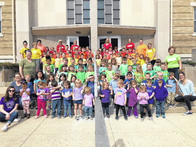 During the week of April 8-12, the 'National Week of of the Young Child' was celebrated by the staff and children of the Center for Creative Childcare in Urbana. They celebrated by creating a giant rainbow on the steps of the Urbana United Methodist Church.