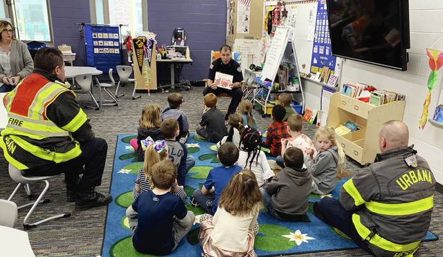 Members of the Urbana Fire Division read to Urbana Elementary School students recently. The program's goal is to introduce firefighters to students.