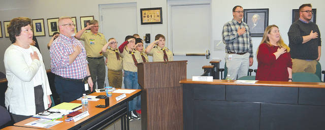 Boy Scouts from Troop 11 led the Pledge of Allegiance at Tuesday's city council meeting, then asked questions of some of the city administrators in order to earn points toward their Arrow of Light badge.