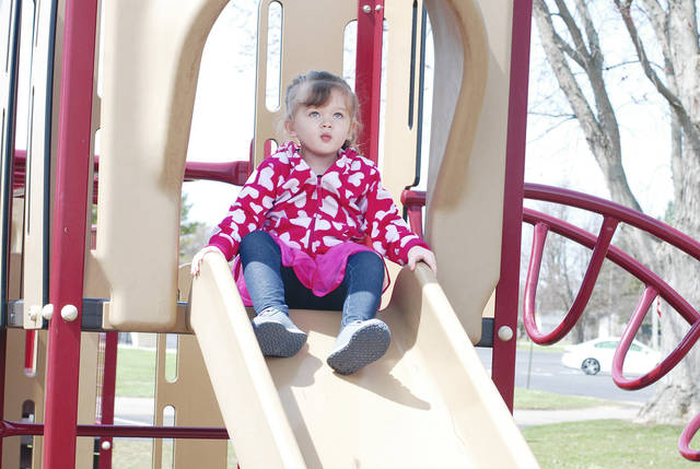 Three-year-old Amelia Deatherage enjoys a sunny early spring day this week at Melvin Miller Park.