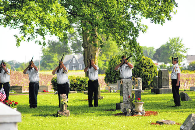 The village of Woodstock's Memorial Day Ceremony on Monday included this honor guard team's rifle salute photographed by West Liberty-Salem student Victoria Wilson (granddaughter of veteran Thad Cushman) — one of the honor guard participants.