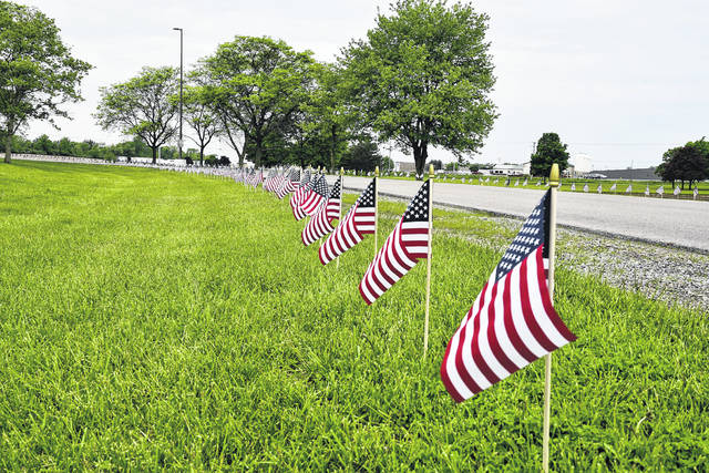 The Diversity and Inclusion Council at Honeywell in Urbana wanted to do something special for Memorial Day. They opted to place 839 United States flags along the drive to the state Route 55 facility. It took Dave Snyder and Ron Miller (employees of Honeywell) two days to measure and place all of the flags. The flags serve as a reminder about the true meaning of Memorial Day.