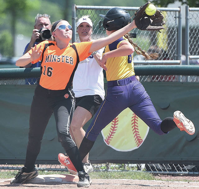 Minster's Laney Hemmelgarn waits for a throw as Mechancisburg's Francys King arrives at first base at Greenville on Saturday.
