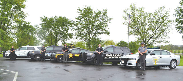 From left to right: St. Paris Police Chief Erica Barga, Urbana Police Officer Mike Cooper, County Sheriff Matt Melvin, Mechanicsburg Police Department Lt. David Patrick and State Highway Patrol Lt. Brian Aller stand in solidarity to support the Click-it or Ticket campaign beginning May 20.