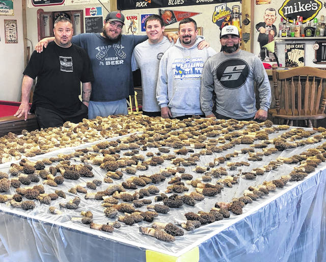 Families have secrets, including the best places to gather mushrooms. Five Champaign County men kept a family tradition by visiting secret local spots May 4-5 and gathered 730 mushrooms to divide among them. Shown with their bounty are, from left, Chad Souders, Larry Lawson, Dylan Souders, Jade Souders and Anthony Gonzalez. Local mushroom hunters have reported a large crop of the spring treasures this year.