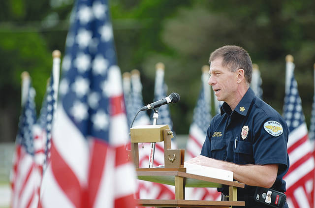 Urbana Fire Chief Dean Ortlieb speaks during Friday morning's ceremony at Grimes Field Airport.