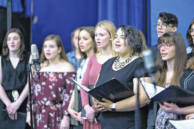 The Urbana University Singers and the Graham High School Choir sang the national anthem during the commencement program.