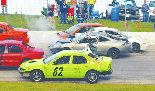 This photo shows action from one of the enduros held last season at Shady Bowl Speedway with three- and four-wide racing. The first 100-lap enduro will take place Saturday at Shady Bowl – weather permitting.
