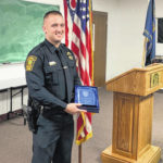 Tim Melvin receives Officer of the Year Award