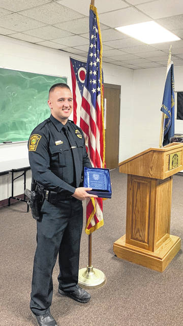 Tim Melvin, an Urbana High School graduate, received the Officer of the Year Award from the Springfield Police Patrolman Association.