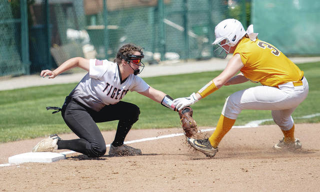 West Liberty-Salem's Hanna Riblet (left) tags out a West Jefferson runner at third base during Saturday's Division III regional final at Wright State. The Tigers lost, 4-2.