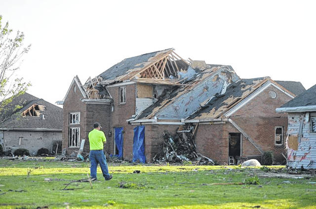 Damaged homes and property after Monday's tornado tore through the city of Celina Ohio.  Richard Parrish | The Lima News