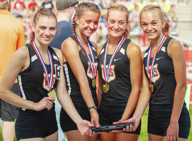 Members of the WL-S girls 3,200-meter relay team – Katelyn Stapleton, Madison Bahan, Grace Adams and Megan Adams – pose after winning the Division III state title on Friday.