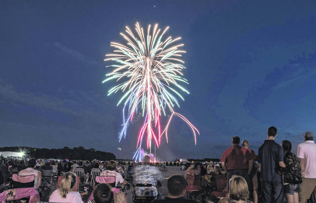 Spectators enjoy the fireworks display at Grimes Field during a past Fourth of July celebration.