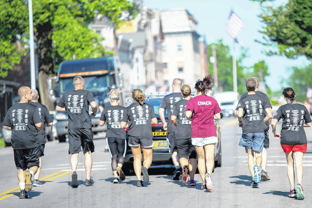 The annual Torch Run for Special Olympics of Ohio was held in Urbana on Tuesday morning. In photo, participants approach Monument Square.