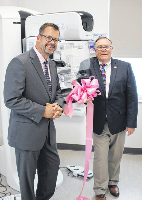 Memorial Health held a Pink Ribbon Cutting Ceremony on Tuesday, June 18, to mark the opening of the organization's new 3D mammography exams at the Memorial Urbana Medical Center at 1958 E. U.S. Route 36 in Urbana. The state-of-the-art technology features Genius™ 3D Mammography™ for a faster, easier and more comfortable experience. Pictured with the new 3D mammography unit are Chip Hubbs, left, CEO/president, Memorial Health, and Urbana Mayor Bill Bean.