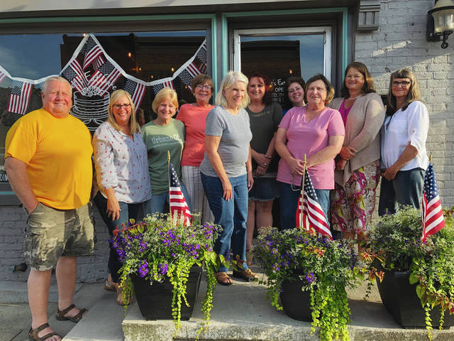 Members of the downtown Urbana business community have organized a sidewalk sale party for Friday and Saturday. Pictured from left are: Mike Manoloff, Oxners; Tina Knotts, Let's Eat Cake; Mary Manoloff, Oxners; Maryann Quigley, Unique Boutique; Patsy Thackery, Cafe Paradiso; Connie Miller, Boston's; Jennifer Loffing, Lilly's Garden; Linda Pastori, Lilly's Garden; Karla Parcels, Unique Boutique; Jan Breslin, Unique Boutique.