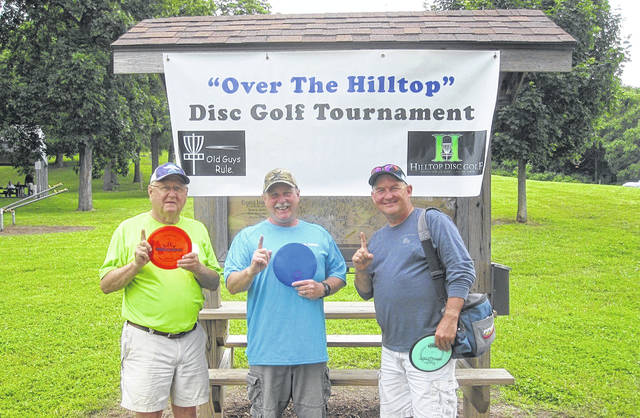 "The Second Annual ""Over The Hilltop"" Disc Golf Tournament was held Saturday, June 22, at the Urbana Hilltop Disc Golf Course, Melvin Miller Park. Proceeds benefit the Hilltop Disc Golf Club for course improvement. First place winners were by age group (left to right): Dan Walter (70+), Jeff McCall (60-69), and Del Wallace (50-59)."