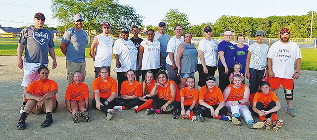 The T A Holland Construction team in Urbana 13-u high school prep softball recently held a players vs. parents game. The parents won, 22-15. Pictured in the front row left to right are players Jalani Davis, Corynn Ryan, Mackenzie King, Lauren Turner, Addy King, Neaveh Cost, Natalie Turner, Bre Stid, Madyson Godwin and Ashlyn Markley. Pictured in the back row are parents Coach Don Turner, Josh Ryan, Blake King, Dawn Barrett, Jillian Davis, Kenisha Davis, Richard Trent, Heather Cost, Tracy Kiser, Stephanie Stid, Lacey Turner, Kaydence Turner, Brevan Staley, Mahnik Hackley and Coach Robbie Cost.