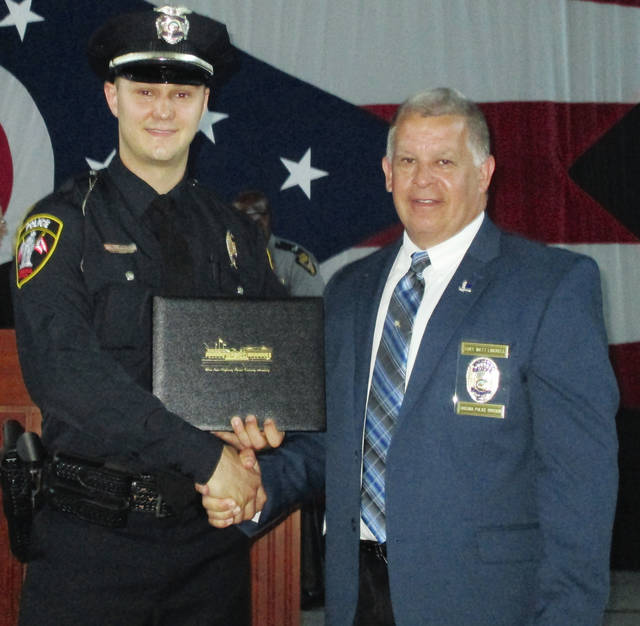 Urbana's newest police officer Christopher Bourque (left) stands with Urbana Police Chief Matt Lingrell after his graduation from the 142nd Basic Peace Officer School of the Ohio Highway Patrol Academy.