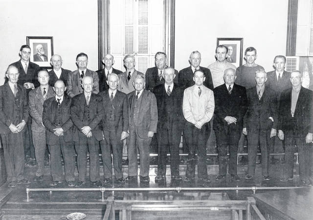 This photo of the 1941 Champaign County Fair Board taken in the Champaign County courthouse includes, back from left, Howard Goddard, Burt Proctor, Ed Hitzler, Herb Everhart, Morris Loveless, Homer Long, Cliff Garner, Donald Bradley, Junior Luse, Erritt Lewis, front from left, Fred Johnson, Kenny Rinehart, Marion Apple, Jake Shambaugh, Frank Zea, Doc Sidders, Charles Barger, Ted Botkin, Charles Ford, Ata Clark and Newt Smith. That year's fair board also included John Yoder, Paul Howard, Glenn Perry, Walter Wilkins and Frank Speece. The photo on wall to the left is of Col. Charles Candy, a Civil War veteran with the 66th Regiment of Ohio Volunteer Infantry. The year 1941 was the 100th anniversary of the fair. The Champaign County Historical Society shared this photo in recognition of all the fair board members who have served and now serve to make the Champaign County Fair an outstanding fair.