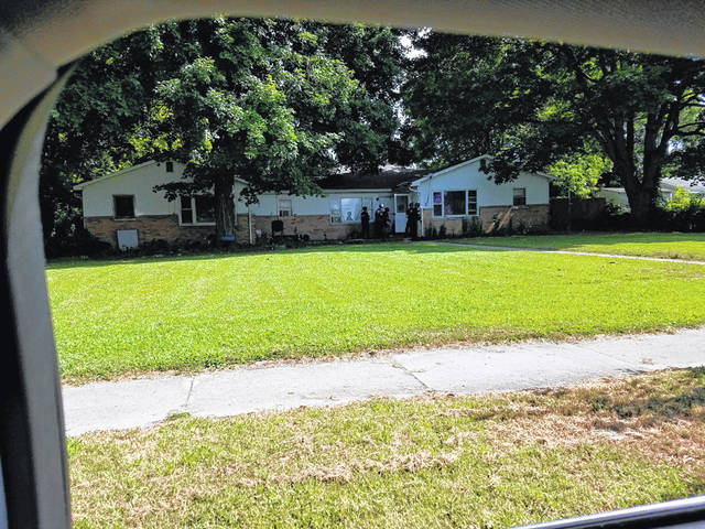 Urbana police officers raided this house at 808 Miami St. on July 12 as part of ongoing drug investigations. A man at the house was charged with drug and weapons offenses.
