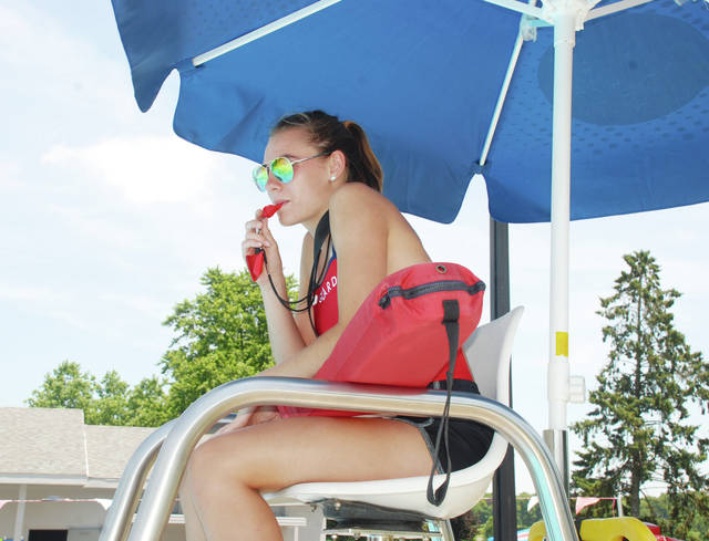 Katelyn Stapleton blows the whistle for break at the city pool on a recent hot afternoon. The pool has been a busy place with temperatures nearing 90 degrees.