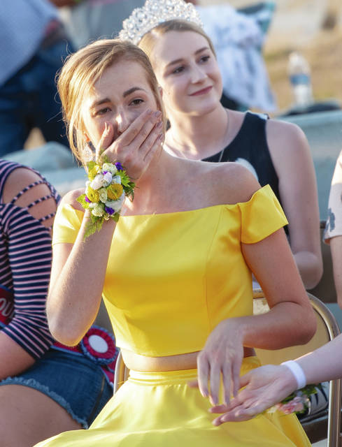 Taylor Ayars reacts to being selected as the 2019 Champaign County Fair Queen during ceremonies on Sunday at the fair.