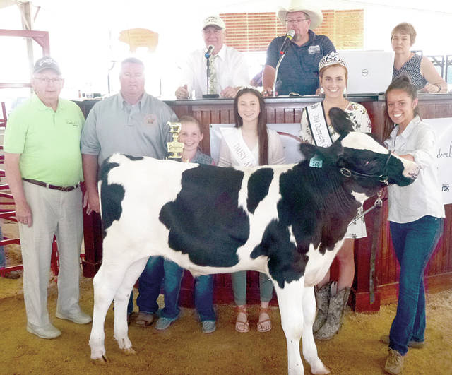 Allyson Cupps' Showman of Showmen dairy feeder was purchased by Sheriff Matt Melvin and Perpetual Federal Savings Bank for $450 at the Champaign County Jr. Fair Market Dairy Feeders Sale on Friday.