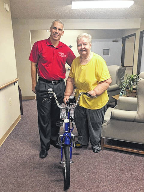 Urbana resident Jackie Cornwell has new wheels thanks to the Senior Dream Center. She's shown here with her new three-wheeled cycle and Frank Lewis of the Senior Dream Center. Lisa Ebert of Messiah Community, Urbana, had contacted the Dream Center about resident Jackie, who wanted a three-wheeler and helmet to have more independence to go grocery shopping, attend church and get around town. The Dream Center fulfilled her wish, thanked Lisa for passing along the wish and welcomes others to call 937-653-4227 with more senior wishes to fulfill.