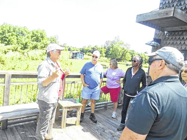 Local retied educators get ready for a tour of Cedar Bog.